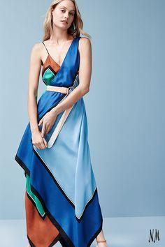Start your week in silk with Diane von Furstenberg. Wrap yourself in luxury with this colorblock, scarf-hem midi dress.