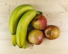Fresh fruit isolated on wooden background - top view