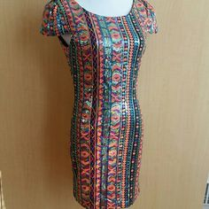 "Sequined tribal rainbow mini cocktail dress boho Stunning rainbow allover sequined tribal mini dress or tunic. Puff sleeves and sexy low back. Fully lined in black. Perfect cocktail or club dress! Size small, 34"" bust. 31"" long shoulder to hem. Brand new with tags. Mittoshop  Dresses Mini"