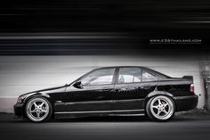 Yeah this makes me want a sedan even more now... Black BMW e36 sedan on cult classic OZ Mito II wheels