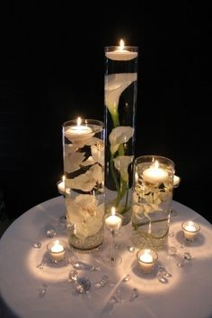 37 Mind-Blowingly Beautiful Wedding Reception Ideas [love candles and flowers in water] How beautiful are these Floating Candle Centerpieces With Flower ! They are inexpensive and gorgeous Simple but amazing !They are wonderful for wedding or Wedding Reception Ideas, Wedding Table Decorations, Wedding Table Numbers, Wedding Centerpieces, Budget Wedding, Wedding Tables, Wedding Receptions, Flower Centerpieces, Calla Lily Wedding Arrangements