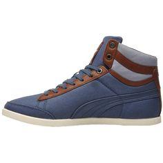 Coole dunkelblaue Sneakers von Puma. Sie haben einen hohen Schaft und bieten einen angenehmen Tragekomfort. - ab 48,00 €