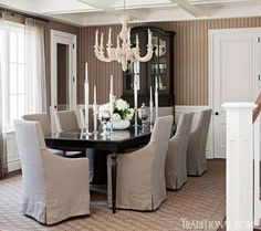 Dining Room in Soft Neutrals  A carved wood chandelier from Circa Lighting illuminates comfy furniture and a neutral-toned rug from Safavieh...