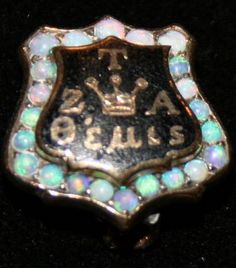This is Grace Elcan Garnett's 1899 opal badge. She was one of the first new members of ZTA. This early badge is one of only a few to have a 3-pointed crown on it, instead of the 5-pointed crown. (From the ZTA Archives)