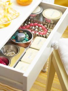 Super (Cheap) Storage -   raid the dollar store & Grandma's kitchen for various tins & pans to tidy the vanity drawer.