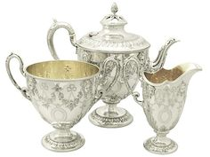 Sterling Silver Three Piece Tea Service - Antique Victorian  SKU: A2328 Price  GBP £2,650.00  http://www.acsilver.co.uk/shop/pc/Sterling-Silver-Three-Piece-Tea-Service-Antique-Victorian-96p4390.htm#.Vjnwpis8rfc
