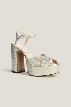 4e41105dac0 Elevate your shoe game with these glitter patent platform peep toe sandal.  A key silhouette this season with a chunky heel and thin ankle strap