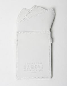 White leather credit card holder from Margiela's Fall 10 accessories collection – an ultra simple design that holds cards securely with an elasticated strap.
