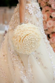 We love how the bride's unique glamelia bouquet, accented by stephanotis, reflects the lines and textures of her gorgeous gown!