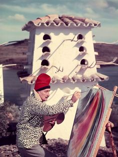 Salvador Dalí on his rooftop studio.(So much Dali, indeed. However he was one of the most photographed artists of our time.  He loved it too.)