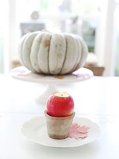 apple candle holder/apples & pumpkins on plates & cake stands.