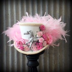 Pink Kentucky Derby hat, Horse and Roses Hat, Horse Mini Top Hat, Alice in Wonderland, Mad Hatter Hat, Mad Tea Party, PInk Hat, Royal Ascot by ChikiBird on Etsy https://www.etsy.com/listing/464518061/pink-kentucky-derby-hat-horse-and-roses