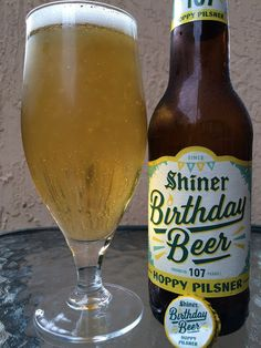 Shiner Birthday Beer 107: Hoppy Pilsner • Crackers with lemon and lightly grassy aroma. More crackers with a gentle malty sweet flavor to start. A definite grassy, flowery, lemony bitter hoppy answer follows. And while that stretch of adjectives might think you're in for a bitter monster, I'd personally say the beer barely met the qualifications to name the beer Hoppy Pilsner. The finish seemed a little off, maybe a hint of wet cardboard. Overall was OK. Happy Birthday!