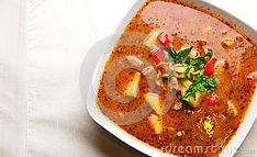 A bowl of spicy goulash soup. Polish way of cooking a traditional Hungarian cuisine.