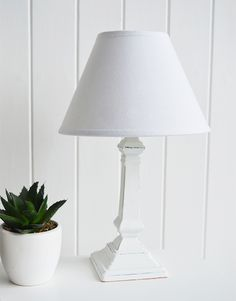 lovely table lamp features a lilac base