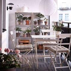 Define Your Dining Space: The paper ceiling light ($20) defines the dining space and dresses the balcony up a bit. Who cares if the table is tiny? Source: Ikea