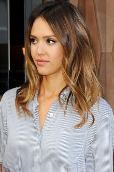 Jessica Alba wore her mid,length hair in sleek curls, on a trip to