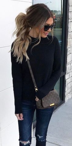 #winter #outfits black sweater and blue distressed denim jeans