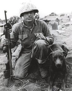 A Marine on Iwo Jima with his dog.