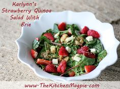 Strawberry quinoa salad with metly brie cheese, kale, spinach and chard. A summer powerhouse of taste and nutrition!