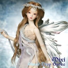 This is Mixi, a water drop sprite ball jointed doll. could her wings be any more perfect? she has crazy water drop feet too!
