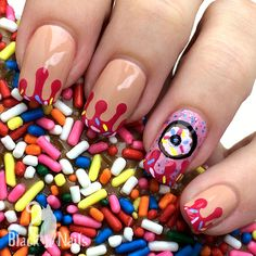 Dripping Donut Nails with Sprinkles! Nail Art #Bella #BundleMonster #Drips #Food #Glitter #HandDrawn #Holiday #Jovana #LAColors #NailArt #Nude #Pink #Poparazzi #SecheVite #WetnWild