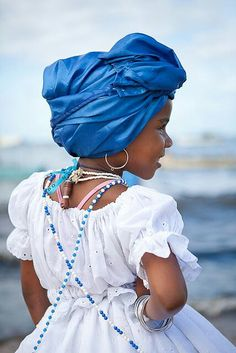 young afro latina child with yemaya's colors blue and white.
