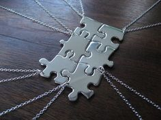 Cute! Use real puzzle pieces covered in mod podge and pretty paper or spray painted chrome. Love this idea so no one gets left out with friendship necklaces!!