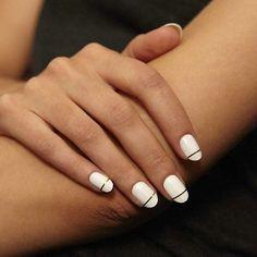 white nails. gold stripe detail.