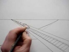How to draw a road, railway and city, using two point perspective. In this video you can see how to draw in perspective, from a simple road that goes to the vanishing point on the horizon line, to a city with many buildings.