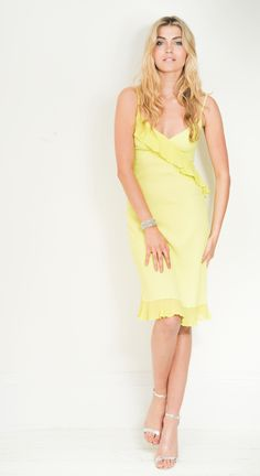 The Lois Lime Dress, £140, on LUX FIX https://lux-fix.com/shop/lois-lime-dress-by-feather-bone