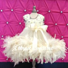 Couture Ivory Feather Edge Flower Girl Dress with chiffon flower bodice and knee length tulle bottom.  Amazing!