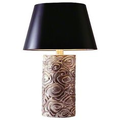 Using elaborate, copper repoussé craftsmanship, this lamp displays a stunning relief texture. The swirling cloud pattern draws from traditional Chinese carvings and art, yet projects a decidedly contemporary feel. The egg-shaped finial appropriately matches the oval base and shade. The design is paired with an ivory linen or black lacquer shade.