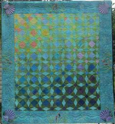 """2012 Opportunity Quilt, """"After the Storm"""", Disconnected Piecers Quilt Guild (Florida). Traditional Storm at Sea block. The colors were arranged progressing from the """"sunshine"""" at the top to the light blue and green """"waters"""" to the purples and dark blues of the """"depths"""", showing how life in the Gulf survived the hurricane."""