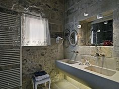 The Relais Masseria Capasa Hotel was completed in 2013 by the Porto Viro based designer Paolo Fracasso. This beautifully styled hotel was built with natural House Design, Bathroom Interior Design, Bathroom Stone Wall, Stylish Bathroom, Diy Bathroom Decor, Small Bathroom Decor, Round Mirror Bathroom, Country House Decor, Bathrooms Remodel