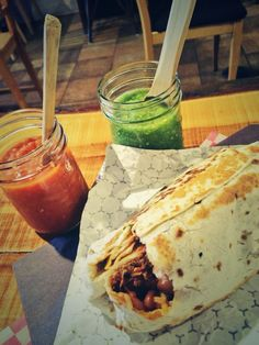 A bursting burrito from Pancho y Emiliano in Kensington Market with two homemade salsas.