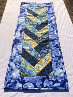 Spring Navy Blue Table Runner Table Topper in A Blue and Yellow Floral Braided Handmade Homemade Quilt Quilted by Heathersquaintquilts on Etsy https://www.etsy.com/listing/495875622/spring-navy-blue-table-runner-table