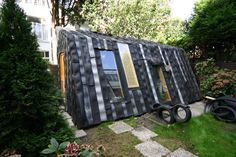 These incredible sheds show what you can build with random recycled materials such as umbrellas, car tires, yogurt containers and even old boat parts.