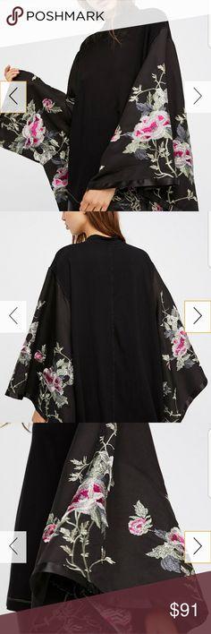 Nwt Free People XS kimono top NWT FREE PEOPLE XS kimono top black with amazing embroidered kimono sleeves. Free People Tops Blouses