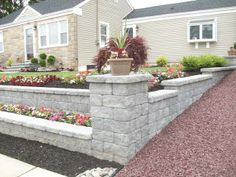 Custom built tiered retaining walls with columns. Morgan, NJ
