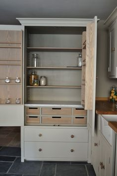 Custom Kitchen Pantry millwork w drawers on lower portion, door storage