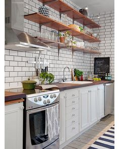 Make It Work: Smart kitchen design solutions for narrow galley kitchens cabinet open cubbies above the cabinets for stashing cookbooks and infrequently used appliances. small kitchen decor for kitchen ideas & inspiration. Kitchen Shelves, Kitchen Backsplash, Kitchen Cabinets, Open Shelves, Backsplash Ideas, Dark Cabinets, Tile Ideas, Upper Cabinets, Kitchen Storage