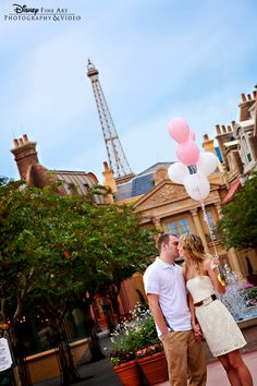 This couple took romantic engagment portraits in Epcot France at Walt Disney World.  It'd be a good idea for a pregnancy announcement also