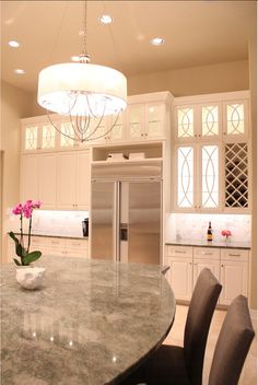 Kitchen Countertop Ideas. The island countertop is Costa Esmeralda polished granite. It has a similar look to marble with the white veining but all the durability and practicality of granite.#Kitchen #Coun