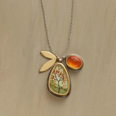 AUTUMN SONATA NECKLACE--Ananda Khalsa paints a miniature maple in full fall regalia. Sterling silver and 22kt gold with carnelian and leaf charms. Hook and eye clasp