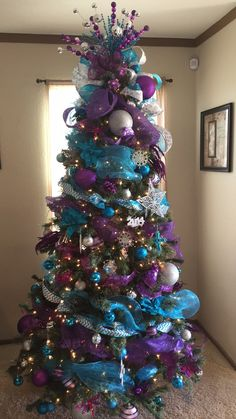 christmas tree ideas turquoise Our 2016 tree. Turquoise and purple Christmas tree Purple Christmas Tree Decorations, Frozen Christmas Tree, Peacock Christmas Tree, Turquoise Christmas, Silver Christmas Tree, Cool Christmas Trees, White Christmas, Xmas Trees, Coastal Christmas