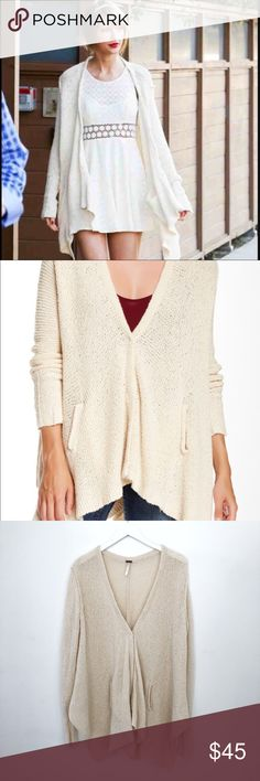 Free People Oversized Cream Cardigan Free People shark bite hem oversized cream cardigan. Has two small gaps in the thread but not really noticeable (see photo). Size medium Free People Sweaters Cardigans