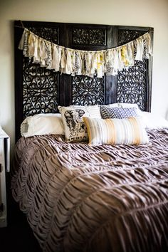 diy fabric banner hanging from headboard in bedroom