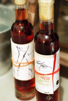 Hand-applied labels work for small batches of wine. Love the shape of the bottle.