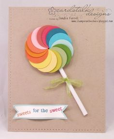 Adorable paper circle lollipop art. Maybe use as a class Valentine or teacher gift.